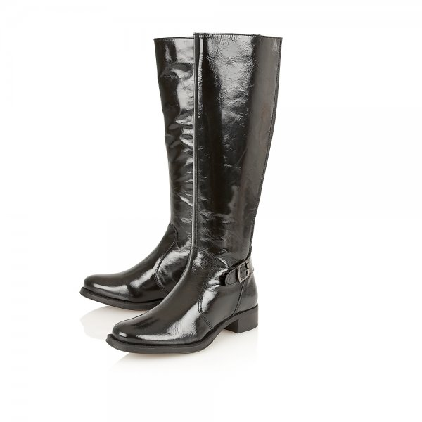 More Details Manolo Blahnik Wakia Leather Cap-Toe Knee Boot Details Manolo Blahnik smooth leather knee boot with patent leather trim.